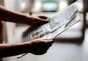 Mensch, der Zeitung liest